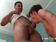 Tough dude pulls his big boner out of his pants and lets boy taste it.