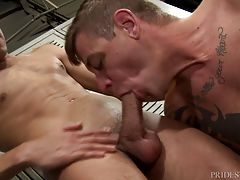 When Zane sees the big cock hanging between Jace`s legs, he cannot help but stare. Zane is then on his knees sucking Jace`s big cock until it gets fully hard. They move from the shower to the locker area and Jace sucks Zane`s big cock.
