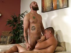 Dustin tells him that he shouldn`t complain because he loves the feel of it on his balls. Jace relents and agrees. Dustin begins sucking Jace`s cock and tickling his balls with his beard, just like Jace likes it. Jace then sucks Dustin before he starts ri