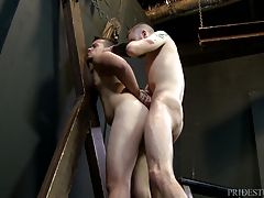 Sebastian sucks his dick then forces Jason to blow him before pushing him up against the cross hands tied to fuck him.