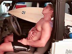 Sexy blonde surfer Brady Jensen starts to rub himself in car.