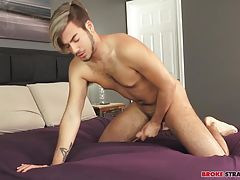 He stands up from the bed, cock still grasped in his hand, stroking and touching himself before getting back on the bed and yanking on that dick harder and faster.  His hips thrust in time with each stroke of his hand, pushing the full length of his prick