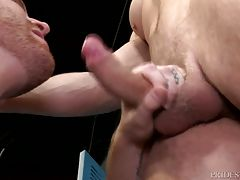 Once he sees the big uncut cock, Jack cannot help but stroke it and start sucking it. Connor then moves to Jack`s ass and begins rimming him. He then starts fucking him deep and hard bent over the bench. Jack rides Connor`s big throbbing cock for a while