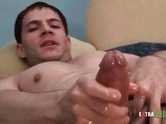 Sexy eager dude passionately rubs his big hard dick.