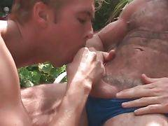 Horny daddy bear offers his thick cock to blond fellow.