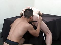 Logan then pulls out a massive black dildo and rams it into the willing ass of Rick, and then climbs up on the table and fucks the dildo into his own hole. Now ass-to-ass, the two begin fucking the massive tool into each other`s hole, as they moan out in