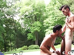 Ricky fucks Cory long and hard on his back as Cory gently strokes his own enormous cock. Driving his cock deep inside his body while his balls slap back and forth on his ass.