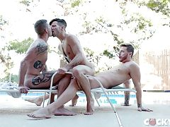 Casey`s expert sucking, alternating between both jumbo cocks, is rewarded by Sean and Josh who put him on all fours astride a lounge chair and take turns rimming his bubble butt and priming it for fucking. In a couple smooth moves Sean is soon ramrodding