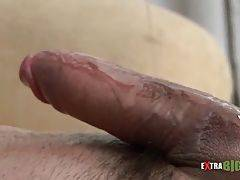 Hungry tough guy lubes and massages his thick cock.