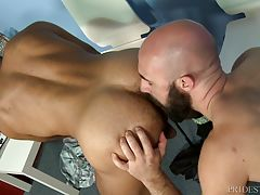 Mike drops to his knees and starts sucking Lex`s big cock. Lex services Mike`s cock before turning him around and rimming his ass deep while stroking his cock from behind. He fucks Mike all over the Doctor`s office until both of them shoot thick loads of